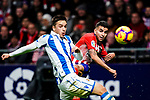 Angel Correa of Atletico de Madrid (R) attempts a kick while being defended by Andoni Gorosabel of Real Sociedad (L) during the La Liga 2018-19 match between Atletico de Madrid and Real Sociedad at Wanda Metropolitano on October 27 2018 in Madrid, Spain.  Photo by Diego Souto / Power Sport Images