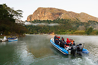 WP40904-D. Boat with scuba divers on the Umzimvubu River near Port St. Johns heads downriver and out to sea early in the morning to experience the world famous Sardine Run, where they hope to swim with dolphins, sharks, whales and birds as they feed on sardines and other baitfish. South Africa, Indian Ocean.<br /> Photo Copyright © Brandon Cole. All rights reserved worldwide.  www.brandoncole.com