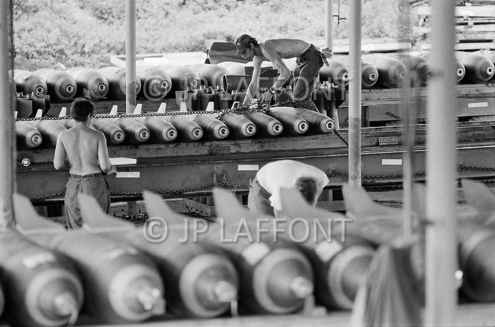 June 1972, Guam --- The Andersen Air Force Base on Guam Island from where the B-52 Stratofortress planes take off for Vietnam. Bombs are prepared before being put in the B-52's store-room. --- Image by © JP Laffont