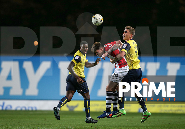 Josh Ruffels (right) of Oxford United clears from Liam McAlinden of Exeter City during the The Checkatrade Trophy match between Oxford United and Exeter City at the Kassam Stadium, Oxford, England on 30 August 2016. Photo by Andy Rowland / PRiME Media Images.