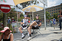 A relaxed Jens Voigt (DEU/Trek Factory Racing) &amp; John Degenkolb (DEU/Giant-Shimano) wait for the peloton to start the last stage of the 2014 Tour de France.<br /> The go is actually given at this point, but Voigt wishes to   savor the moment as this will be his very last TDF stage ever... after participating in 17(!) editions.<br /> <br /> 2014 Tour de France<br /> stage 21: Evry - Paris Champs-Elys&eacute;es (137km)
