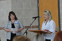 NWA Democrat-Gazette/FLIP PUTTHOFF<br /> WELCOME TEACHERS<br /> Dena Ross, director of human resources at the Bentonville School District, welcomes teachers during the New Teachers Luncheon held Tuesday at Bentonville High School. Shelley Parson (cq) (left) with Farmers Insurance hears her remarks. Teachers and administrators heard words of encouragement from school officials and business representatives that work with the school district. Drawings for prizes were also held.