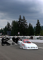 Aug. 3, 2013; Kent, WA, USA: NHRA funny car driver Paul Lee during qualifying for the Northwest Nationals at Pacific Raceways. Mandatory Credit: Mark J. Rebilas-USA TODAY Sports