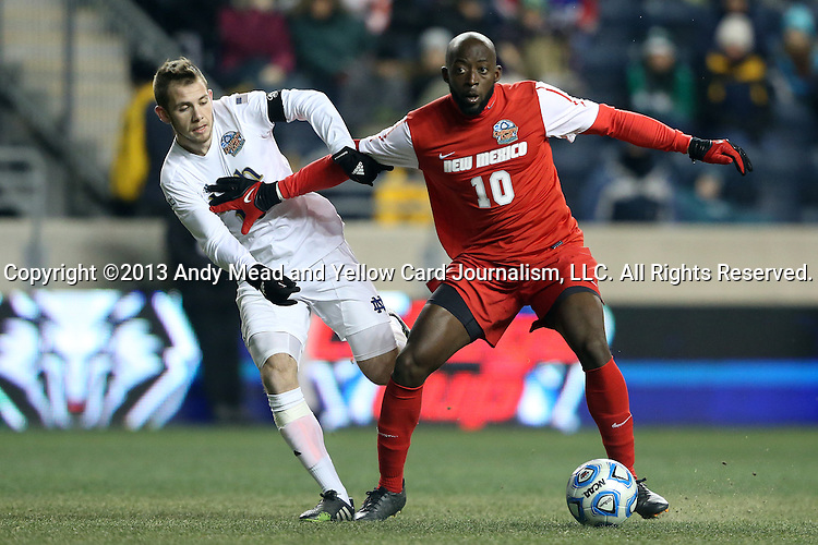 13 December 2013: New Mexico's Michael Kafari (GHA) (right) and Notre Dame's Harrison Shipp (left). The University of Notre Dame Fighting Irish played the University of New Mexico Lobos at PPL Park in Chester, Pennsylvania in a 2013 NCAA Division I Men's College Cup semifinal match. Notre Dame won the game 2-0.