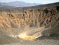 UBEHEBE CRATER - DEATH VALLEY NATIONAL MONUMENT<br /> Caldera Formed by Hydrovolcanic Eruption<br /> A rising plume of molten basalt came in contact with overlying water table which flashed to steam, creating an explosive pressure that knocked off the mantle of sedimentary rock to form a crater  &frac12; mile across &amp; 770' deep &amp; revealing conglomerate layers.