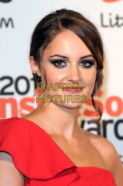 PAULA LANE .Attending the Inside Soap Awards 2010 held at Shaka Zulu, Camden, London, England, UK, September 27th 2010. .portrait headshot make-up red one shoulder ruffle .CAP/DH.©David Hitchens/Capital Pictures.