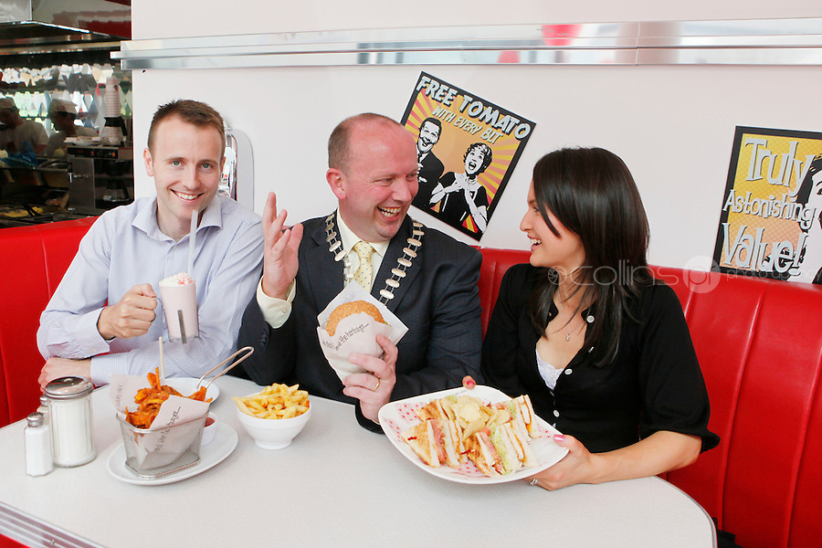 25/8/2011.Matt and Kelly Finn the first Eddie rockets franchisee in Kildare are pictured with Kildare Mayor, Clr Michael Nolan at the opening of the new Eddie Rockets City Diner in Nass Co Kildare. Picture James Horan/Collins Photos
