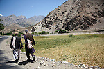 11 June 2013, Rukha Hospital, Panjshir, Panjshir Provnce, Afghanistan.   Two local men walk along the road on the trip from Kabul to Panjshir. Picture by Graham Crouch/World Bank.