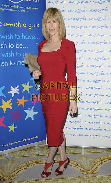 KATE GARRAWAY.At the Make-A-Wish Winter Ball, Dorchester Hotel, Park Lane, London, England, UK, November 27th 2010..full length red long sleeve dress open toe shoes beige clutch bag .CAP/CAN.©Can Nguyen/Capital Pictures.