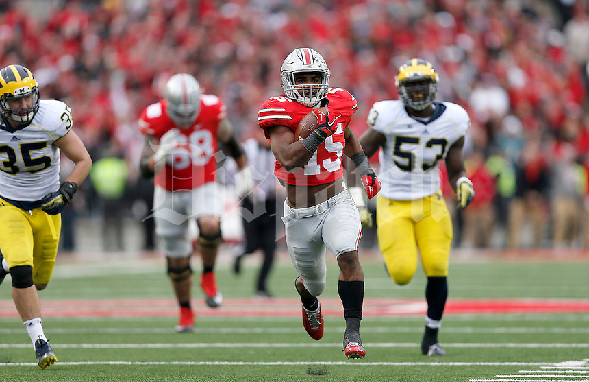 Ohio State Buckeyes running back Ezekiel Elliott (15) runs during a 44 yard touchdown in the fourth quarter of the NCAA football game against Michigan at Ohio Stadium on Saturday, November 29, 2014. (Columbus Dispatch photo by Jonathan Quilter)
