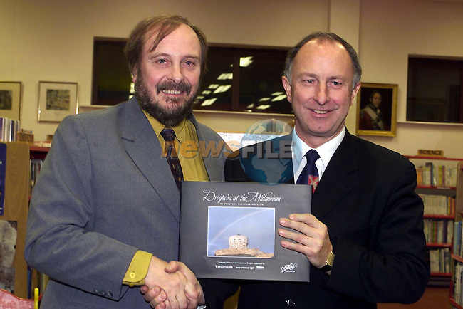 John Butler presents Minister Dermot Ahern with the New book by members of the Drogheda Camera Club.Pic Fran Caffrey Newsfile