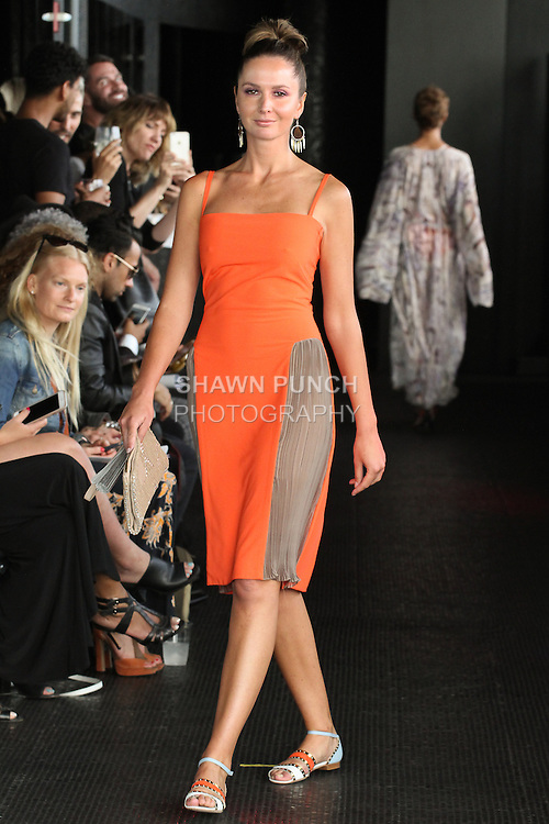 Delphine walks runway in a short matte jersey Gladys dress from the Carlton Jones Resort 2017 collection fashion show at Le Bain in The Standard Hotel in New York City, on June 8, 2017.