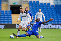 Sol Bamba of Cardiff City tackles Johnny Russell of Derby County during the Sky Bet Championship match between Cardiff City and Derby County at Cardiff City Stadium, Cardiff, Wales on 30 September 2017. Photo by Mark  Hawkins / PRiME Media Images.