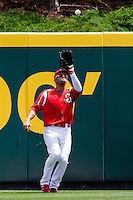Alex Castellanos (18) of the Springfield Cardinals catches a fly ball to center field during a game against the San Antonio Missions on May 30, 2011 at Hammons Field in Springfield, Missouri.  Photo By David Welker/Four Seam Images