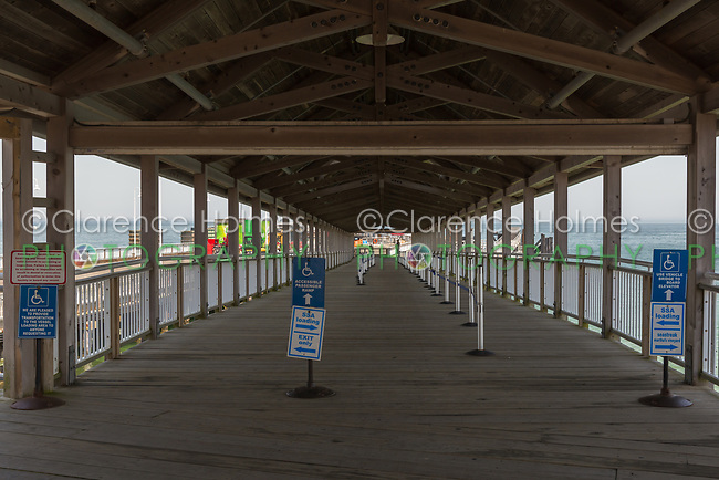 A covered pier leads travelers to the ferries arriving and departing the Oak Bluffs ferry terminal in Oak Bluffs, Massachusetts on Martha's Vineyard.