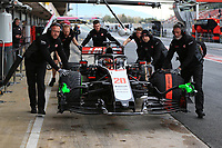 27th February 2020; Circuit De Barcelona Catalunya, Barcelona, Catalonia, Spain; Formula 1 2nd Pre season Testing Day Two; Haas F1 Team pushes the car of Kevin Magnussen to inspection