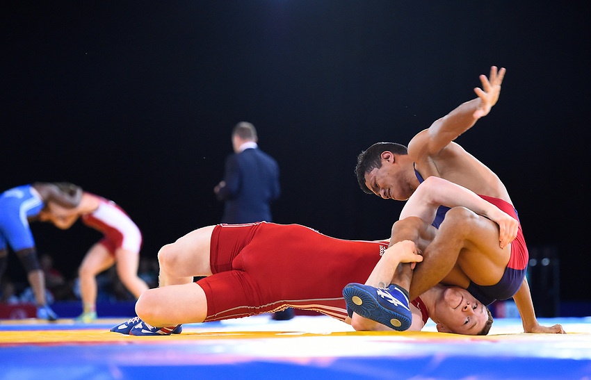 Wales' Tommy Hawthorn (wearing red) defeats Bangladesh's Dipu Ray in the Wrestling FS 74kg round of 16<br /> <br /> Photographer Chris Vaughan/CameraSport<br /> <br /> 20th Commonwealth Games - Day 6 - Tuesday 29th July 2014 - Wrestling - SECC - Glasgow - UK<br /> <br /> © CameraSport - 43 Linden Ave. Countesthorpe. Leicester. England. LE8 5PG - Tel: +44 (0) 116 277 4147 - admin@camerasport.com - www.camerasport.com