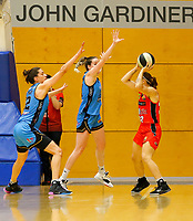 29th December 2019; Bendat Basketball Centre, Perth, Western Australia, Australia; Womens National Basketball League Australia, Perth Lynx versus Canberra Capitals; Alison Schwagmeyer-Belger of the Perth Lynx looks to get a jump shot away from the gaurding Capitals players - Editorial Use