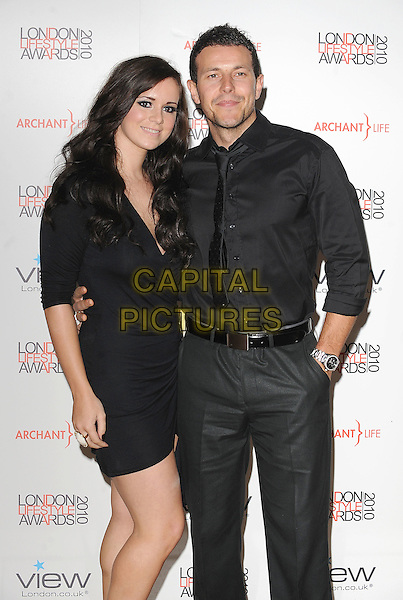 GUEST & LEE LATCHFORD EVANS.attending The London Lifestyle Awards, Park Plaza Riverbank, London, England, UK, England, 7th October 2010..half length dress couple belt  black beard facial hair tie .CAP/BEL.©Tom Belcher/Capital Pictures.