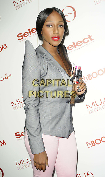 Alexandra Burke.The MUA Lip Boom new lip gloss range launch party, The Rose Club, London, England..April 11th, 2012.half length grey gray suit jacket blazer shoulder pads pink lipstick jeans denim ponytail side.CAP/CAN.©Can Nguyen/Capital Pictures.