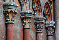 Architectural detail of the apsidial Chapelle de la Vierge, or Chapelle de la Petite Paroisse, restored under Viollet-le-Duc in the 19th century in 13th century style, with carved and painted pillars, capitals and arches and a painted plaster wall, in the Basilique Cathedrale Notre-Dame d'Amiens or Cathedral Basilica of Our Lady of Amiens, built 1220-70 in Gothic style, Amiens, Picardy, France. Amiens Cathedral was listed as a UNESCO World Heritage Site in 1981. Picture by Manuel Cohen