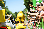 Hands out as the publicity caravan passes ahead of the race during Stage 3 of the 2018 Tour de France a Team Time Trial running 35.5km from Cholet to Cholet (35,5km, France. 9th July 2018. <br /> Picture: ASO/Pauline Ballet | Cyclefile<br /> All photos usage must carry mandatory copyright credit (&copy; Cyclefile | ASO/Pauline Ballet)