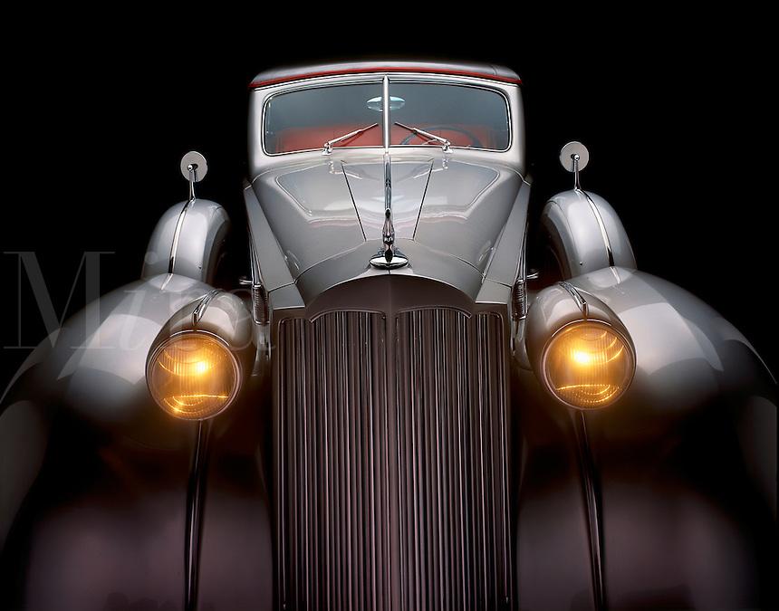 A grey 1930's Packard.