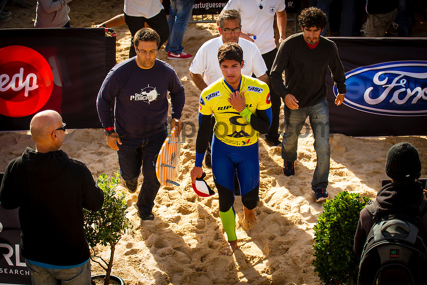 SUPERTUBOS, Peniche/Portugal (Friday, October 19, 2012) Gabriel Medina (BRA) waiting for the result of the final to be called out. - Julian Wilson (AUS), 23, has claimed his maiden ASP World Championship Tour (WCT) victory today, besting a rampaging Gabriel Medina (BRA), 18, in the dying seconds of the Rip Curl Pro Portugal...Stop No. 8 of 10 on the 2012 ASP World Championship Tour, the Rip Curl Pro Portugal played host to pivotal moments in the hunt for the 2012 ASP World Title as well as today's dramatic culmination between two rising superstars...In a replay of the surfers' Final match-up from France last season, Medina and Wilson went blow-for-blow in today's Final in front of a capacity crowd at Supertubos. While Medina favored a more technical approach to the heat, executing a number of progressive maneuvers, it was Wilson's barrel sense and combination ability that ultimately tipped the heat in the final moments...?I'm overwhelmed,? Wilson said. ?I lost to Gabriel (Medina) on the buzzer last year in France and to beat him back again on the buzzer, I don't even know how to describe the feeling. He was trying to hold onto the lead in the end there, he pretty much did what I did in the Final last year in France. He was too busy worrying about me, and that wave came in the dying moments and that was the scorer. I don't know what to say, I'm just so happy.?..Wilson's final wave, a multi-section barrel followed by a number of turns, came in at an 8.43 and gave the Australian the edge with no time left on the clock. Both surfers arrived to the shoreline without knowing who had won the Final. Photo: joliphotos.com