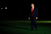 United States President Donald J. Trump walks on the South Lawn of the White House upon his return to Washington from Greenville, North Carolina on Wednesday, July 17, 2019. <br /> Credit: Yuri Gripas / Pool via CNP