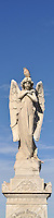 A bird sits on a statue of an angel on a grave at Waverley Cemetery in Bronte, a seaside suburb of Sydney.