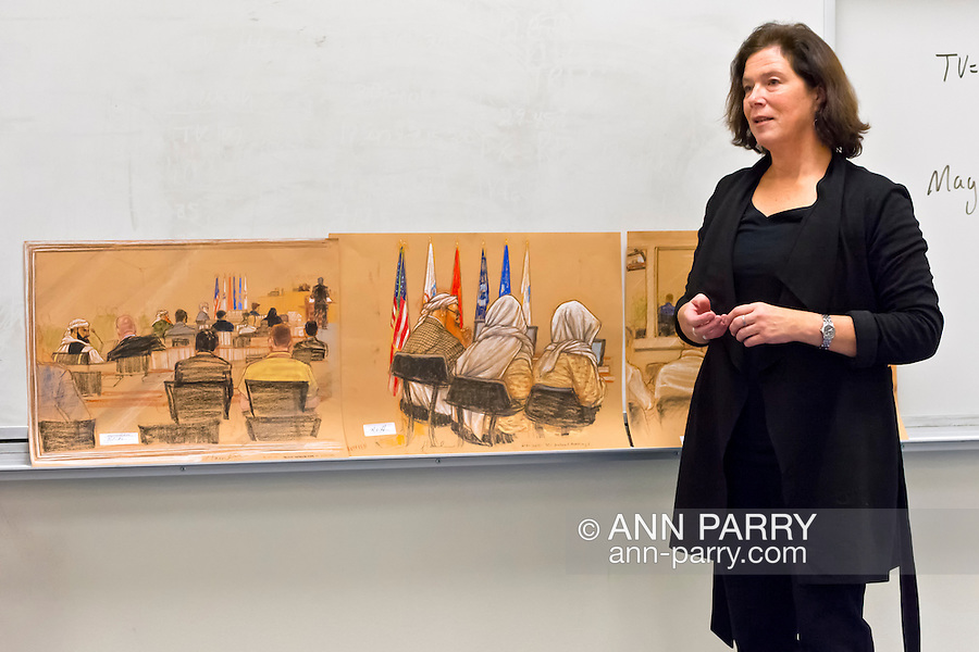 """Hempstead, New York, U.S. 12th November, 2013. Janet Hamlin, a courtroom artist covering the military tribunals at Guantanamo Bay since 2006, shows her charcoal drawings and discusses her work at Hofstra University. Much of the time she was the only journalist providing a visual record of the events at the United States naval base in Cuba, and her new book """"Sketching Guantanomo"""" is a collection of her images."""