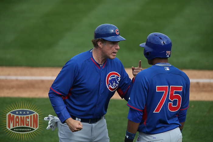 TEMPE, AZ - MARCH 12:  Will Ferrell of the Chicago Cubs lectures Addison Russell while coaching third base during the spring training game against the Los Angeles Angels on March 12, 2015 at Tempe Diablo Stadium in Tempe, Arizona. (Photo by Brad Mangin)