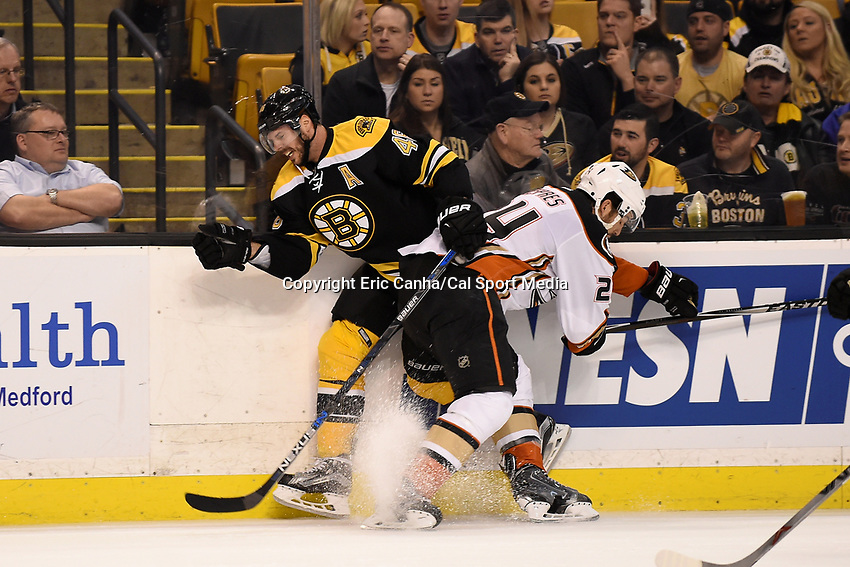 Tuesday, January 26, 2016: Anaheim Ducks defenseman Simon Despres (24) checks Boston Bruins center David Krejci (46) during the National Hockey League game between the Anaheim Ducks and the Boston Bruins, held at TD Garden, in Boston, Massachusetts. Anaheim defeats Boston 6-2. Eric Canha/CSM