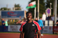 Tuesday 15th July 2014<br /> Pictured: Christian Malcolm<br /> RE: Welsh Sprinter Christian Malcolm smiling straight to camera as he warms up for the 4x100m relay at the Welsh Athletics International in Cardiff International Sports Stadium, South Wales, UK. His last race on home soil.
