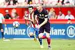 Sporting de Gijon's Moi Gomez (l) and FC Barcelona's Jeremy Mathieu during La Liga match. September 24,2016. (ALTERPHOTOS/Acero)