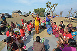 Women and children dance during the gathering of an emotional support group in Makaising, a village in the Gorkha District of Nepal that was hard hit by a devastating 2015 earthquake.
