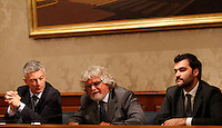 Il leader del MoVimento 5 Stelle Beppe Grillo, al centro, affiancato dal Capogruppo al Senato Nicola Morra, sinistra, e dal Capogruppo alla Camera Riccardo Nuti, tiene una conferenza stampa al Senato, dopo aver incontrato il Capo dello Stato al Quirinale, Roma, 10 luglio 2013.<br /> Italian blogger, comedian and Five Stars Movement's leader Beppe Grillo, center, flanked by head of Senators Nicola Morra, left, and head of Deputies Riccardo Nuti, speaks during a press conference at the Senate after meeting the Head of State at the Quirinale, in Rome, 10 July 2013.<br /> UPDATE IMAGES PRESS/Riccardo De Luca