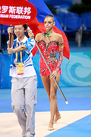 August 22, 2008; Beijing, China; Rhythmic gymnast Evgenia Kanaeva of Russia carries flag during march-in ceremony on way to winning gold in the individual final at 2008 Beijing Olympics..(©) Copyright 2008 Tom Theobald