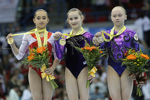 Unven bars podium with Diana Laura Bulimar of Romania in third place, left, Victoria komova of Russia in second place, right and Anastasia Grishina of Russia in first place during the juniors women apparatus final at the European Artistic Gymnastics Championship at National Indoor Arena in Birmingham, UK on May 2, 2010