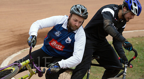 21 JUN 2015 - LONDON, GBR - Les Fellgett (left) of Ipswich Eagles falls as he challenges Max Renna of East London for position during their South East League Two cycle speedway fixture at Canning Town Recreation Ground in London, Great Britain (PHOTO COPYRIGHT © 2015 NIGEL FARROW, ALL RIGHTS RESERVED)