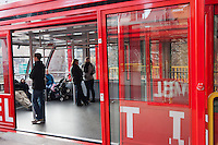 Passengers on-board the newly renovated Roosevelt Island Tram in the Manhattan station awaiting departure for Roosevelt Island.