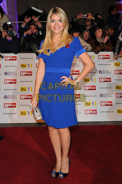 HOLLY WILLOUGHBY .Attending the Pride of Britain Awards 2010,Grosvenor House, Park Lane, London, England, UK, .November 8th 2010..arrivals full length blue dress hand on hip poppy pregnant nails nail polish varnish manicure rings peep toe shoes silver clutch bag maternity .CAP/CAS.©Bob Cass/Capital Pictures.