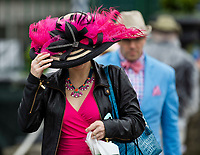 LOUISVILLE, KY - MAY 05: A woman arrives dressed to the nines on Kentucky Oaks Day at Churchill Downs on May 5, 2017 in Louisville, Kentucky. (Photo by Jesse Caris/Eclipse Sportswire/Getty Images)