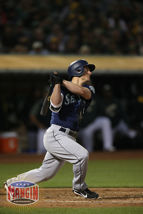 OAKLAND, CA - AUGUST 13:  Kyle Seager #15 of the Seattle Mariners bats against the Oakland Athletics during the game at the Oakland Coliseum on Monday, August 13, 2018 in Oakland, California. (Photo by Brad Mangin)