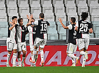 Calcio, Serie A: Juventus - Lazio, Allianz Stadium, July 20, 2020.<br /> Juventus' Cristiano Ronaldo (l) celebrates after scoring his second goal with his teammates during the Italian Serie A football match between Juventus and Lazio at the Allianz stadium in Turin, July 20, 2020.<br /> UPDATE IMAGES PRESS/Isabella Bonotto