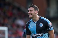 Matthew Bloomfield of Wycombe Wanderers questions a decision during the Sky Bet League 2 match between Leyton Orient and Wycombe Wanderers at the Matchroom Stadium, London, England on 19 September 2015. Photo by Andy Rowland.