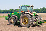 2008 John Deere 8430 tractor with seed drill planting corn in a field