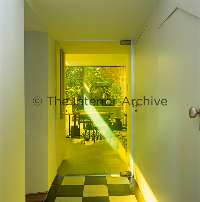 A shaft of sunlight through the yellow glass door which represents Gizard's reinterpretation of stained glass