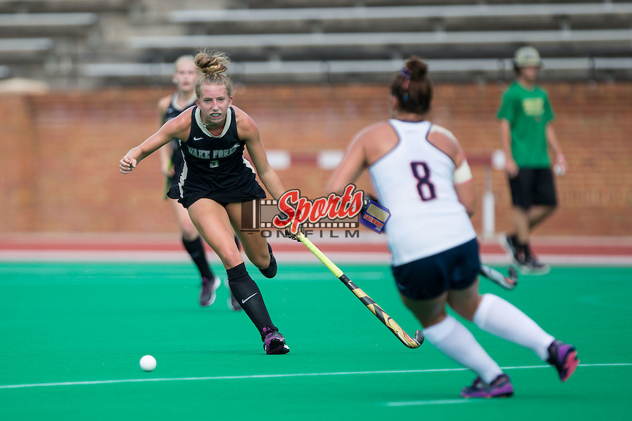 Emily Adamson (9) of the Wake Forest Demon Deacons tries to get the ball away from Hannah Jones (8) of the Liberty Flames during first half action at Kentner Stadium on September 20, 2015 in Winston-Salem, North Carolina.  The Demon Deacons defeated the Flames 2-1.  (Brian Westerholt/Sports On Film)