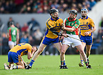 Niall Gilligan of Sixmilebridge and  Conor Harrison of Clooney-Quin tussle during their senior county final replay at Cusack park. Photograph by John Kelly.